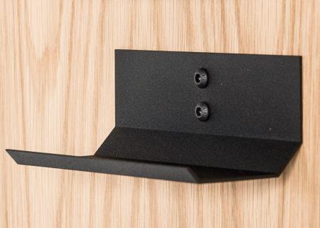 Black wine cradle on an Oak board