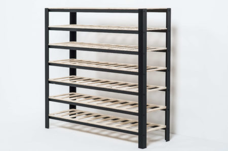 Empty classic wine rack showing the black aluminum and birch ply shelves